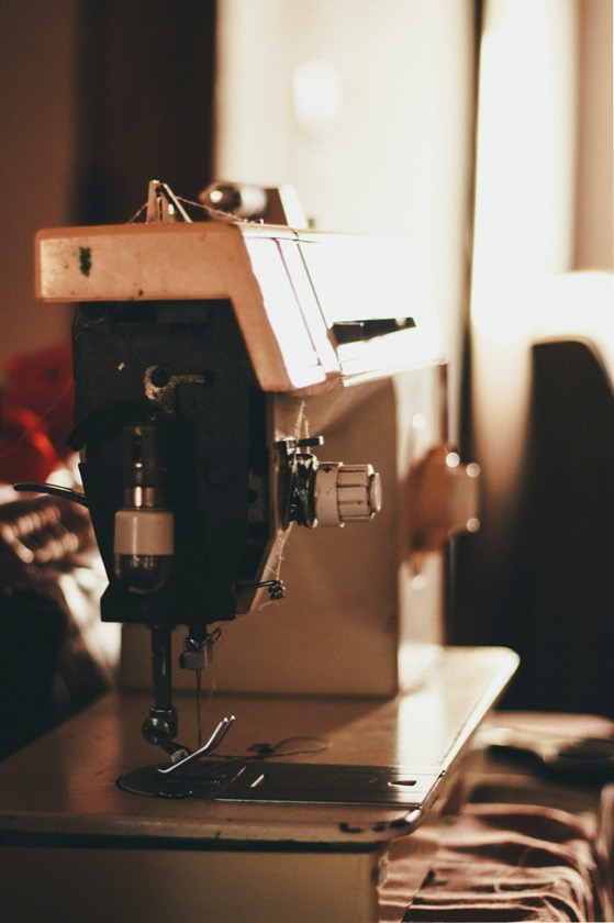 closeup photo of gray and black electric sewing machine